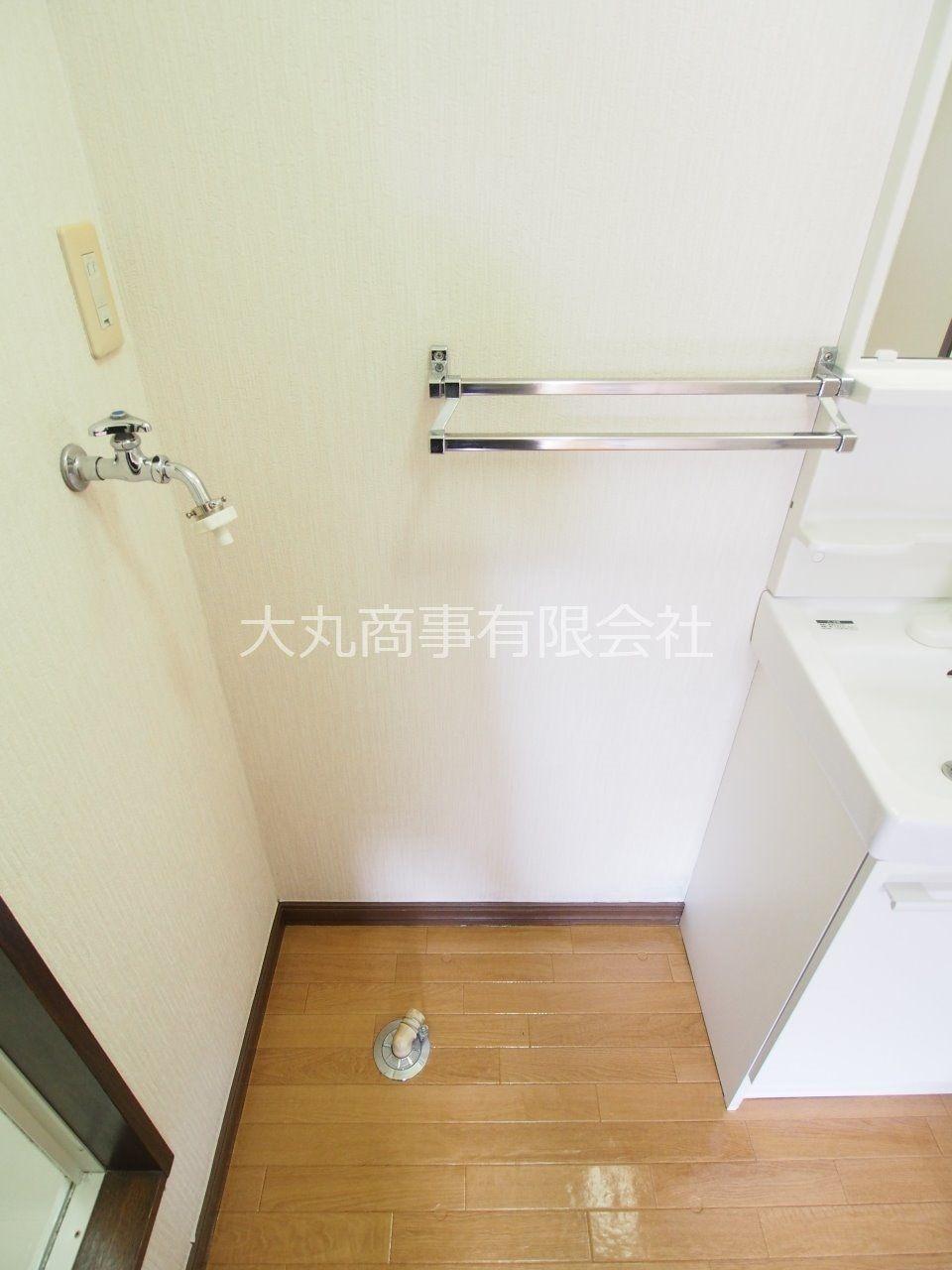 洗面台の横の室内洗濯機置場