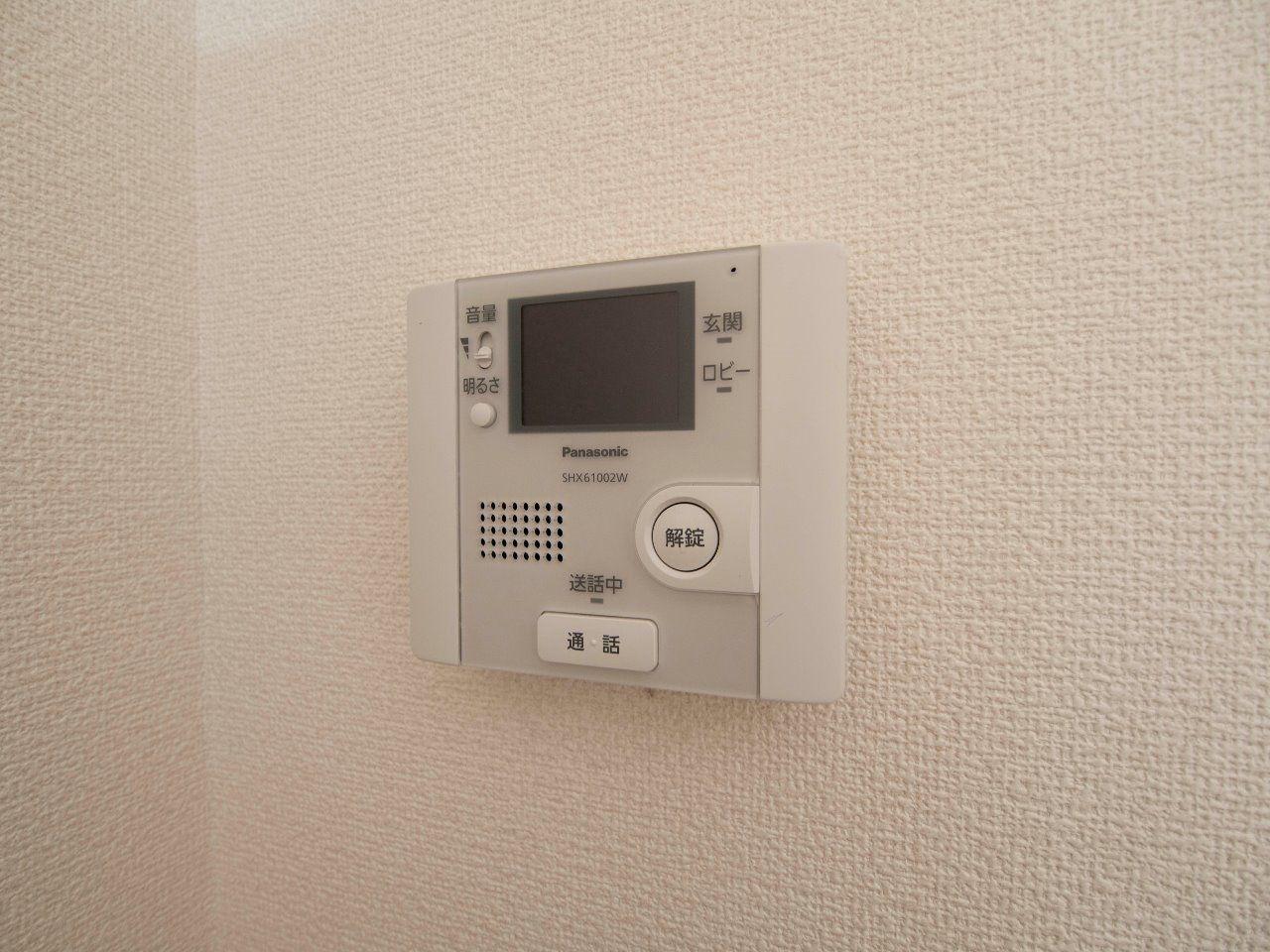 オートロック操作盤も兼ねたインターホン受話器